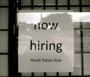 sign saying 'now hiring - must have a clue""