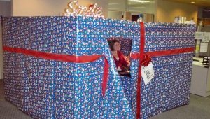 a desk wrapped in Christmas paper, like a children's fort