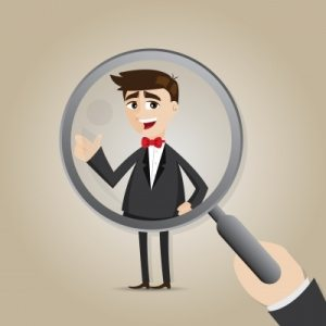Magnifying glass on staff member - recruitment myths
