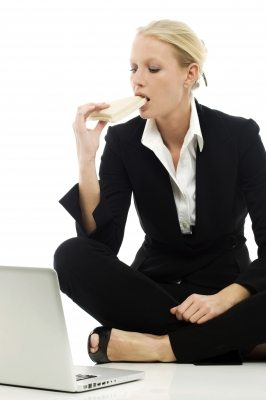 woman eating a wrap at work