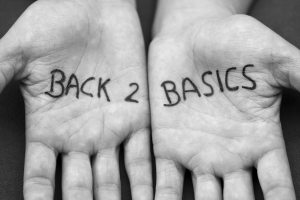 2 hands with 'back to basics' written on them