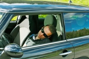 man napping in his car