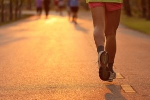 legs of someone running in the morning