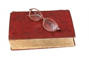 A book with a pair of glasses