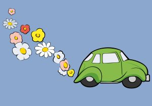 a Volkswagen with flowers coming out it's exhaust pipe