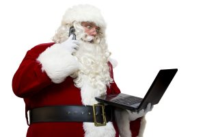 Santa with a laptop and a phone negotiating