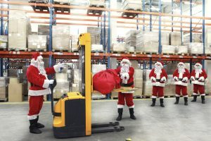 santas in a workshop loading their sacks into machines