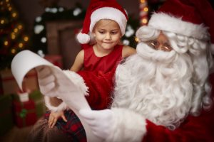 Santa talking to a little girl