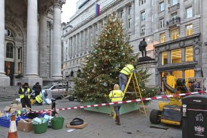 LONDON, UNITED KINGDOM - NOVEMBER 23: Decorating Christmas Tree in London on NOVEMBER 23, 2013. Workers Erected Big Christmas Tree in Front of Royal Exchange in London, United Kingdom.