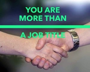 two people shaking hands with caption - you are more than a job title