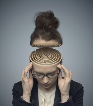 Conceptual image of a labyrinth in the woman's brain