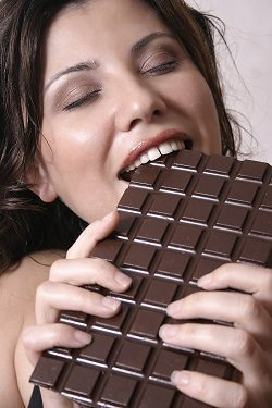 Woman Eating a large block of chocolate