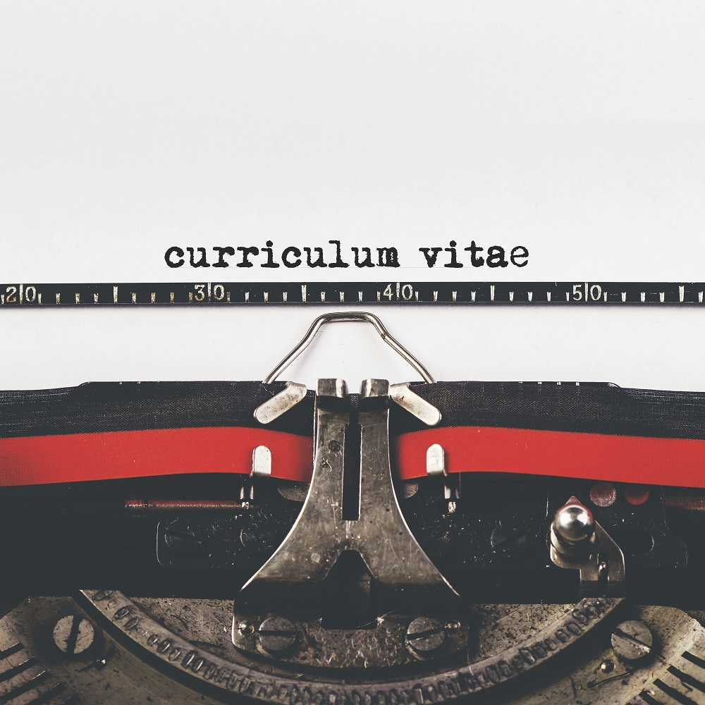 Curriculum Vitae type on old typewriter machine, vintage retro toned hipster style for job application, selective focus