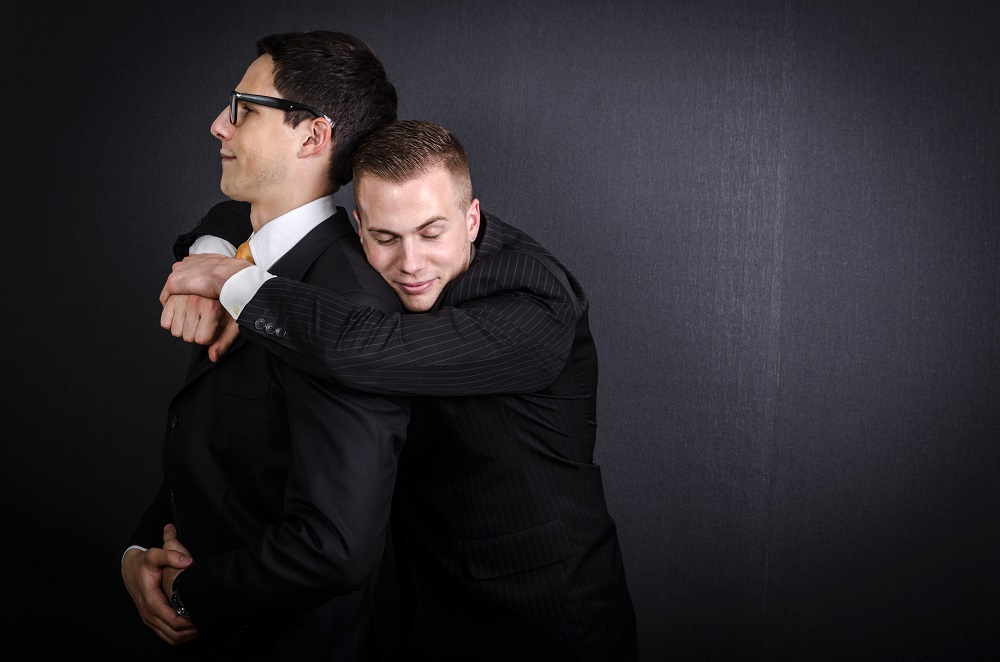 a recruitment consultant hugging a candidate lovingly