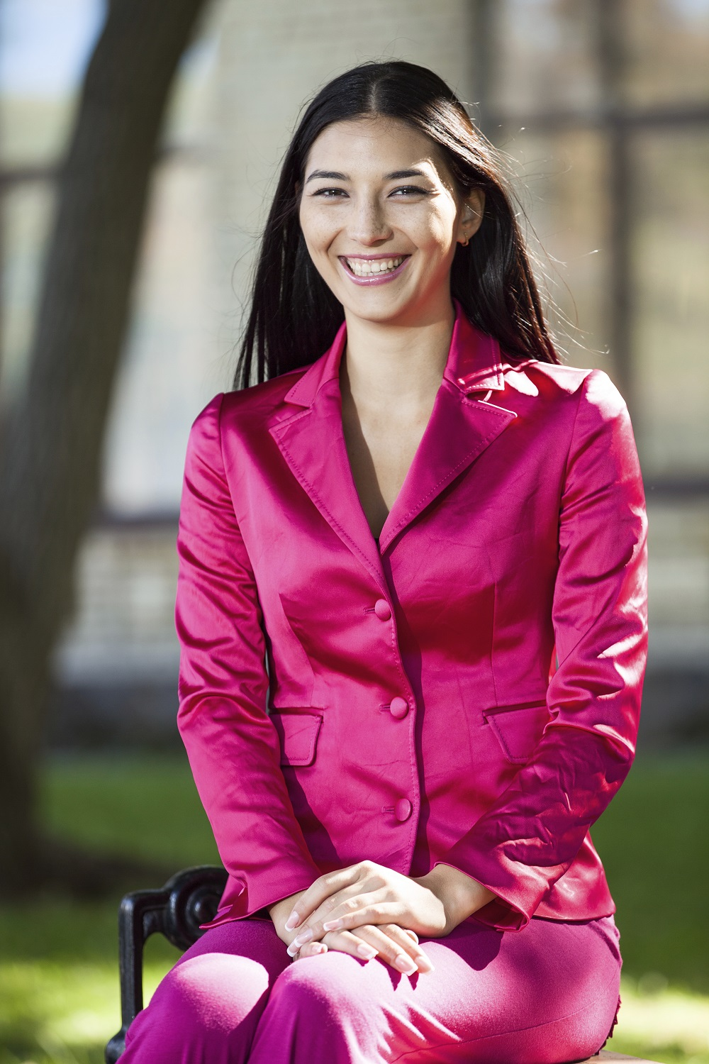 woman in a bright fuschia suit