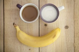 smile made out of bananas and cups of tea