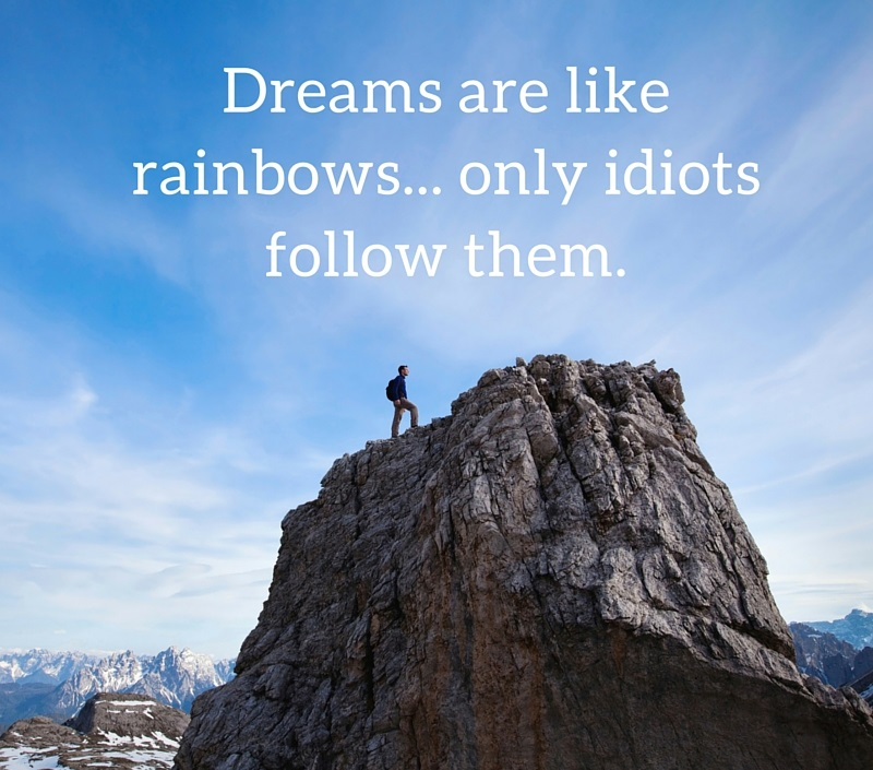 a571bc513 man standing on top of mountain with demotivational quote 'dreams are like  rainbows, only