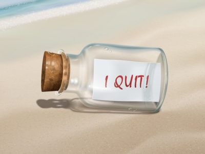 I quit message in a bottle isolated on beautiful beach