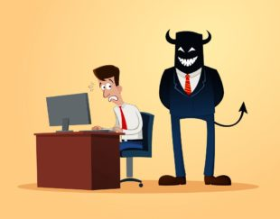 man typing at computer with boss behind him (devil horns)