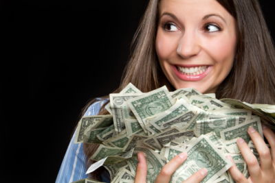 Beautiful smiling woman holding money