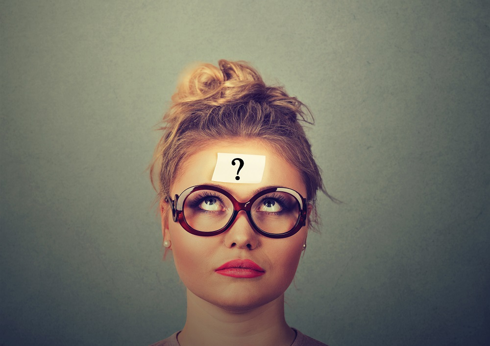 woman looking upwards with a question mark on her head